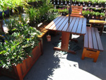 "48"" Patio Bench with table, planters and chairs"